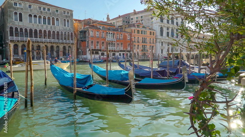 14748_Some_of_the_Venetian_gondolas_being_tied_on_the_poles_in_Italy.jpg